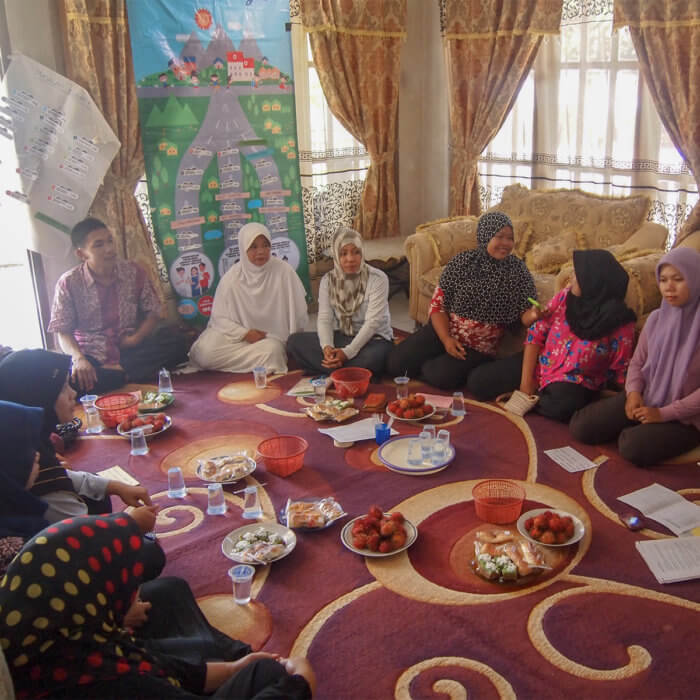 Community representatives in Indonesia meeting about their actions taken as part of the Transparency for Development project.