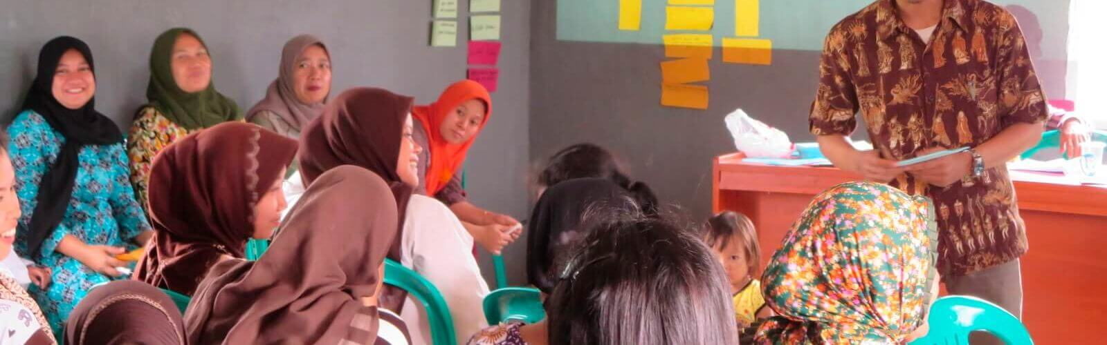 A community-based organization in Indonesia meets in a school