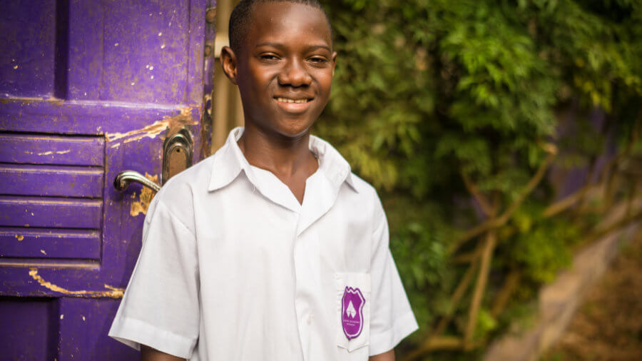 Christian Thomas, 13 years old, is a JSS2 student at Rising Academy Network's Regent school in Freetown, Sierra Leone. ©Results for Development