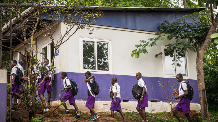 Students arrive for school at Rising Academy Network's Regent School in Freetown, Sierra Leone. ©Results for Development