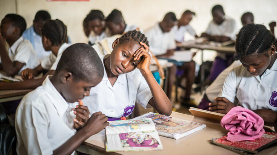Salima Kamara and Michael Conteh are JSS2 students at Rising Academy Network's Regent School in Freetown, Sierra Leone. Salima and Michael are improving their reading skills through a literacy improvement program at the school, co-developed with Results for Development ©Results for Development